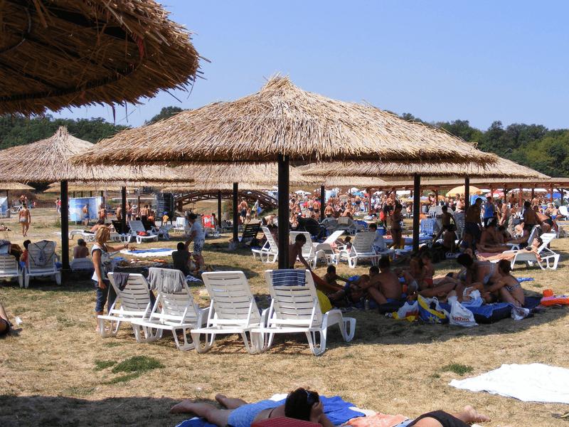 Rustic umbrellas at Baile Figa